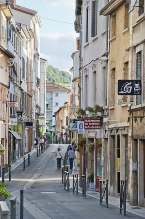street with small shops in Vienne France near the Rhone River  Editorial