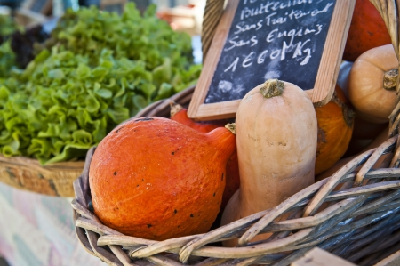 basket of squash for sale at farmers market in Condrieu France