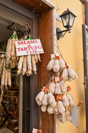 cured Italian Meats at grocery market in Castiglione del Lago in Umbria Italy