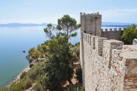 Fortress at Castiglione del Lago on the Shore of Lake Trasimeno Imagens