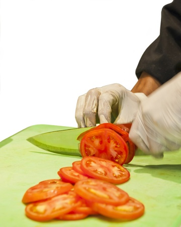 cutting vegetables: Chef Slicing Tomatoes restaurant