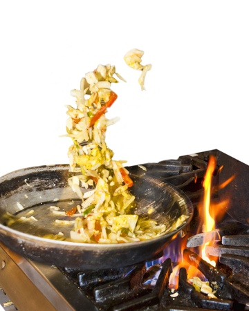 culinary tourism: Toss   Catch with a Hot Skillet  Stock Photo
