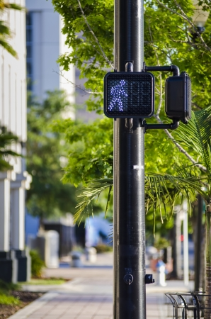 proceed: street crossing signal for pedestrians in downtown orlando