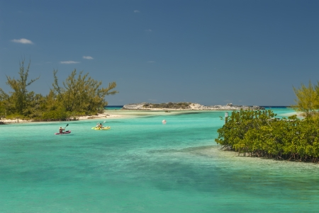 cat island: kayakers headed out of a harbor at Cat Island Bahamas Stock Photo