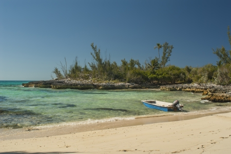 a fishing boat in a safe harbor at Cat Island Bahamas Stock Photo