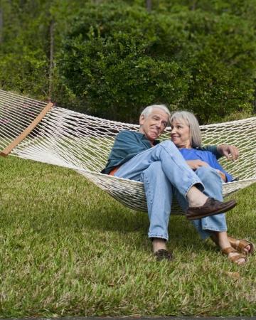 expressive senior couple in hammock age 550-60