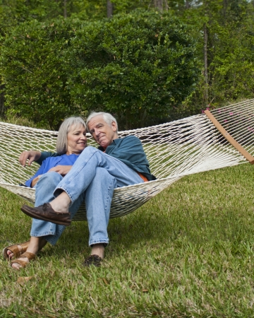 expressive senior couple in hammock age 550-60 Stock Photo - 15059703