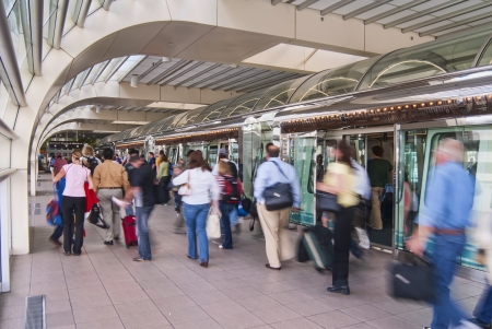 travelers departing the shuttle for their gate at Orlando International Airport