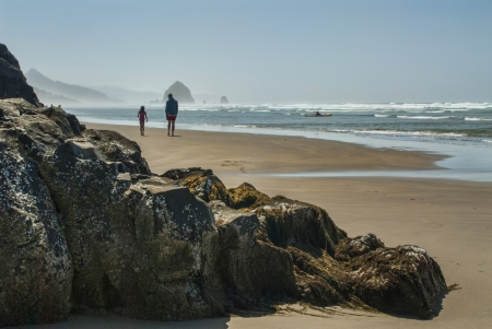 northwest: Father and Daughter Walk on Beach