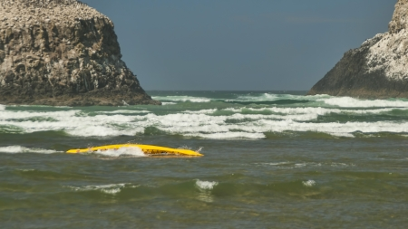 Overturned Kayak in Ocean waves