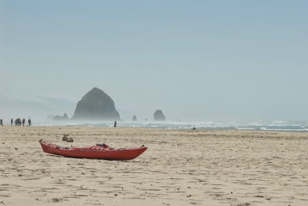 Kayak Resting on Cannon Beach with Haystack in the background