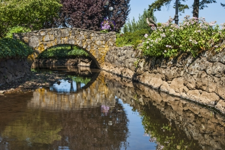 Stone Bridge over Canal with reflections