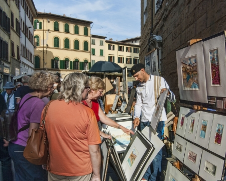 Painter selling art on the street in Florence