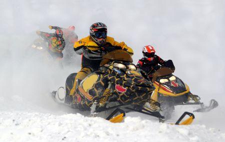 snowmobile racing action