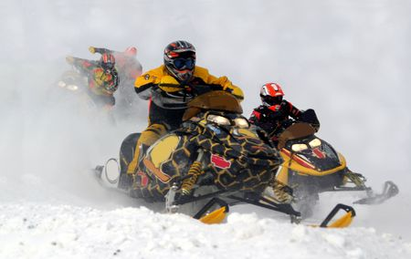 wintersports: snowmobile racing action