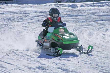 幼児 snowmobiler 写真素材