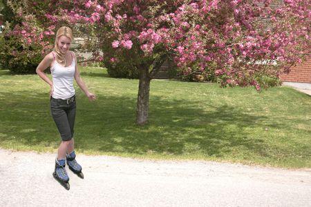 roller: roller blading down street