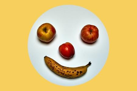 minimalist round fruit face made of apple, peach and banana Reklamní fotografie