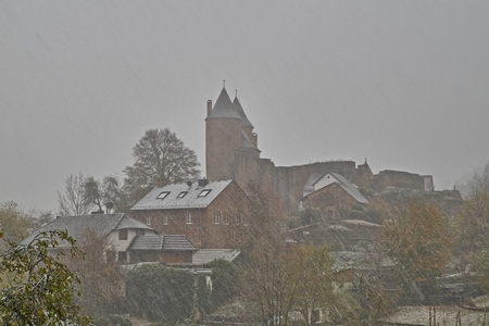 Autumn snowstorm on October 30 in Germany, Bertradaburg in Muerlenbach, Eifel.