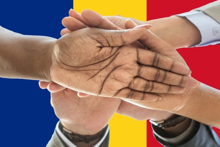 Romania flag, intergration of a multicultural group of young people.