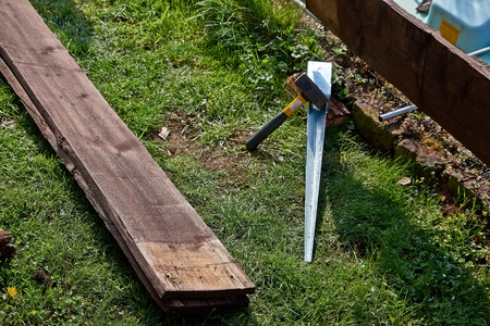 ground felling sleeves of galvanized metal for wood posts