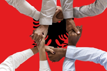 Albania flag, intergration of a multicultural group of young people. 스톡 콘텐츠