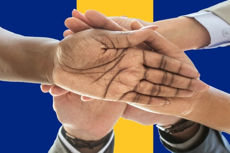 Flag of Barbados, intergration of a multicultural group of young people.