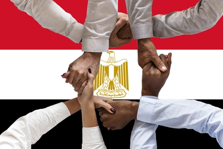 Flag of Egypt, intergration of a multicultural group of young people. Imagens