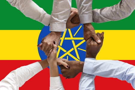 Flag of Ethiopia, intergration of a multicultural group of young people.