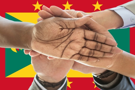 Flag of Grenada, intergration of a multicultural group of young people. 스톡 콘텐츠