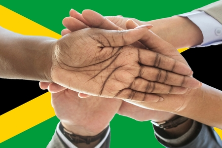 Flag of Jamaica, intergration of a multicultural group of young people. Imagens