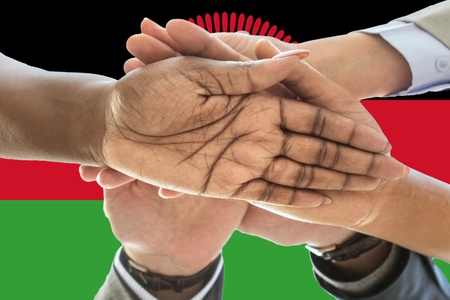 Flag of Malawi, intergration of a multicultural group of young people.