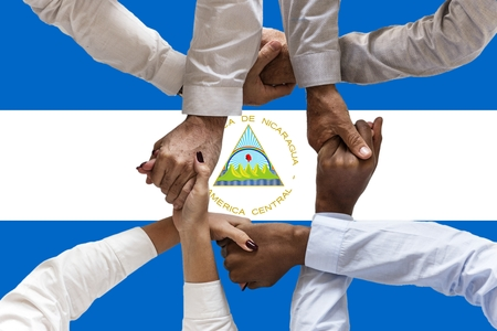 Flag of Nicaragua, intergration of a multicultural group of young people.