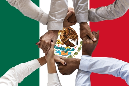 Flag of Mexico, intergration of a multicultural group of young people.