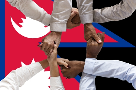 Flag of Nepal, intergration of a multicultural group of young people.