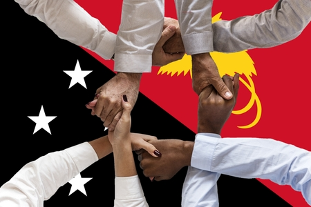 Flag of Papua New Guinea, intergration of a multicultural group of young people.