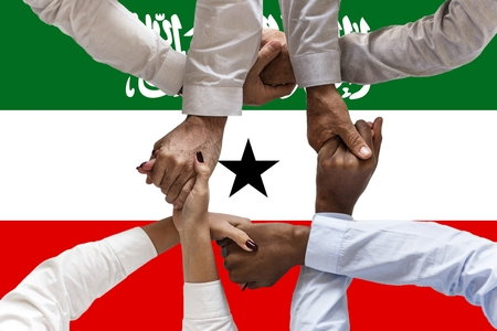 Flag of Somaliland, intergration of a multicultural group of young people. 스톡 콘텐츠