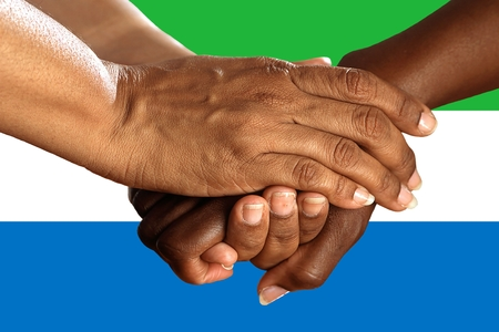 Flag of Sierra Leone, intergration of a multicultural group of young people.
