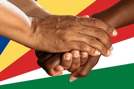 Flag of Seychelles, intergration of a multicultural group of young people. 스톡 콘텐츠