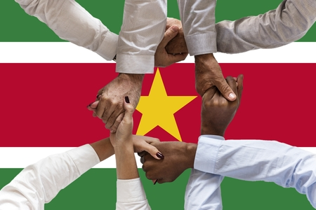 Flag of Suriname, intergration of a multicultural group of young people 스톡 콘텐츠