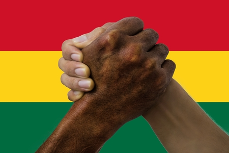Flag of Ghana, intergration of a multicultural group of young people.