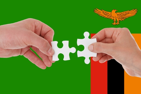 zambia flag, intergration of a multicultural group of young people.