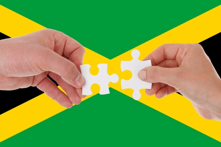Flag of Jamaica, intergration of a multicultural group of young people. 스톡 콘텐츠