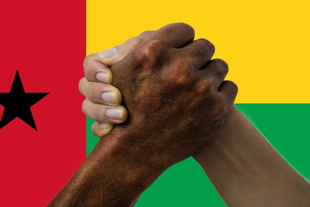 Flag of Guinea-Bissau, intergration of a multicultural group of young people.