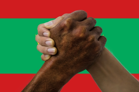 Flag of Mauritania, intergration of a multicultural group of young people.
