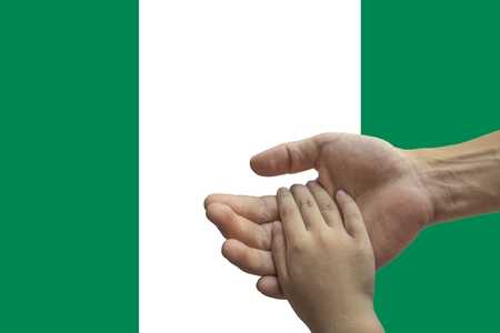 Nigeria flag, intergration of a multicultural group of young people.