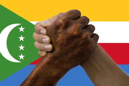 Flag of the Comoros, intergration of a multicultural group of young people.