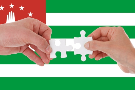 abkhazia flag, intergration of a multicultural group of young people.