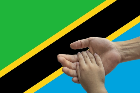 Tanzania flag, intergration of a multicultural group of young people.
