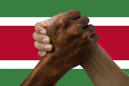 Flag of Suriname, intergration of a multicultural group of young people. 스톡 콘텐츠